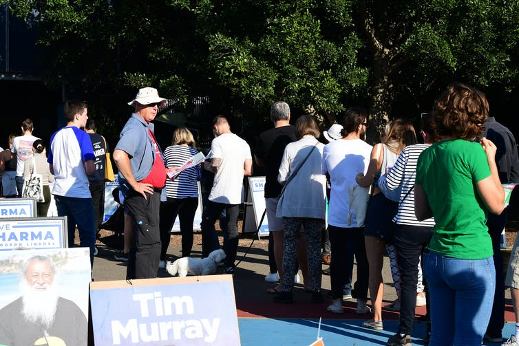Australians line up outside a polling booth on Election Day 2019.