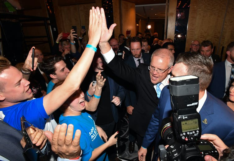 Scott Morrison high fives supporters on election night 2019.