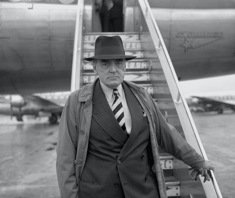 Lord Reith about to board a flight to South Africa in 1956.