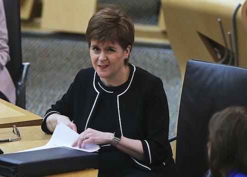 Nicola Sturgeon frowning at the camera.