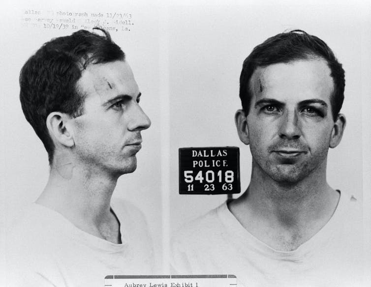 Black and white image of Oswald from the side and front