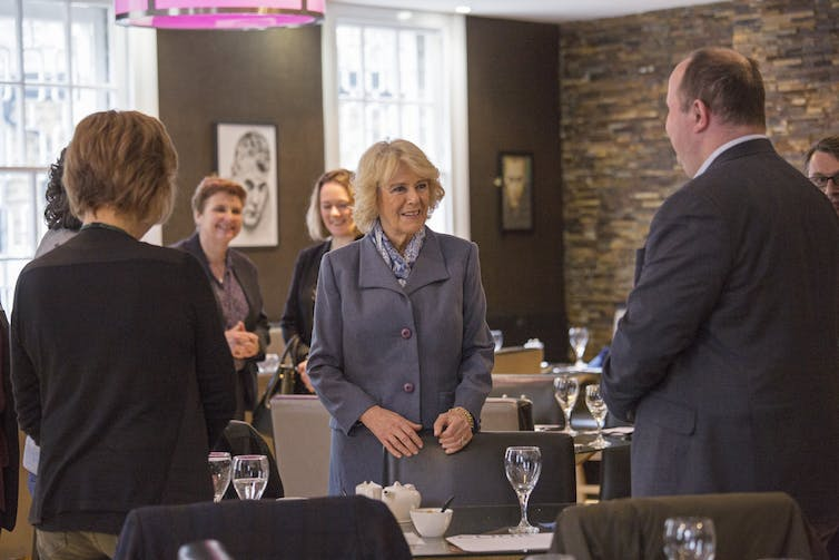 Camilla, Duchess of Cornwall with other people in a restaurant