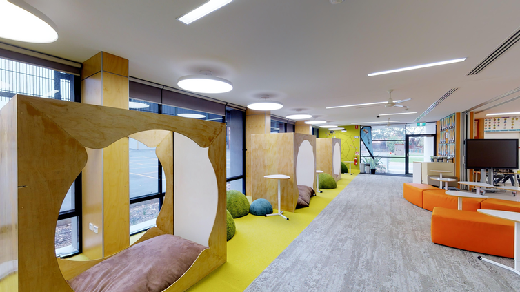 A classroom with flexible furniture and soft areas for independent learning.