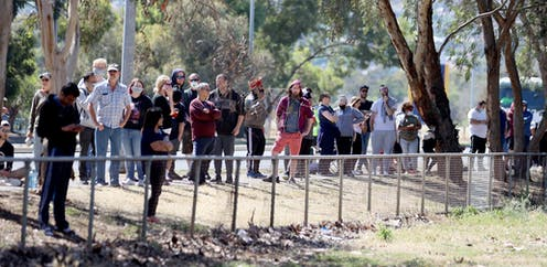 People queue for COVID testing at Parafield airport in Adelaide.