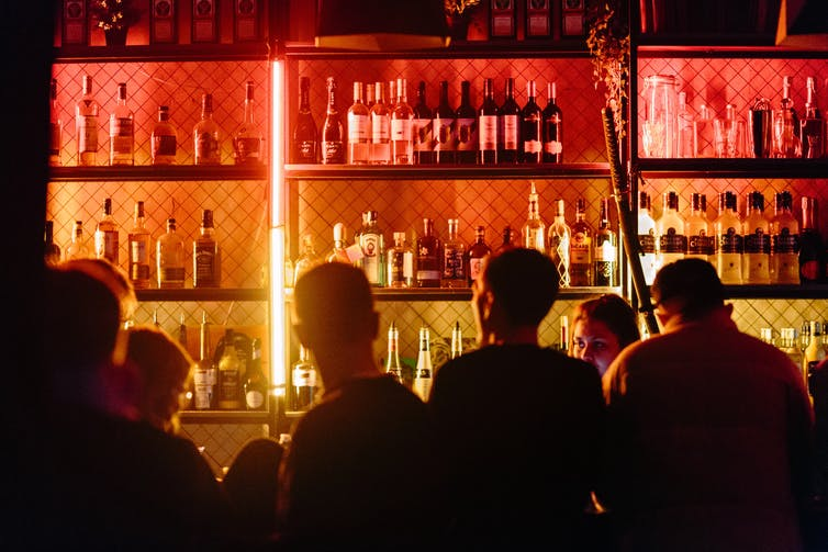 Men are seen at a bar.