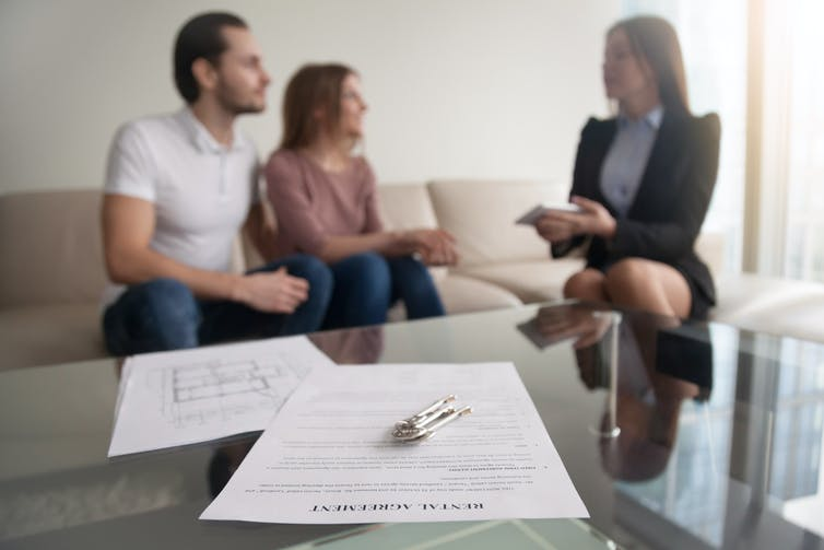 Tenants talking to agent