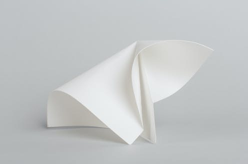 A piece of paper with curved folds forming an origami