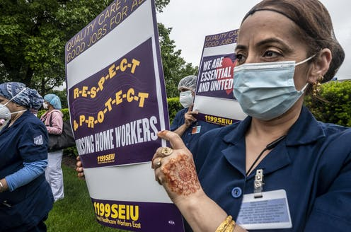 Nursing home workers protest working conditions in New Hyde Park, New York.