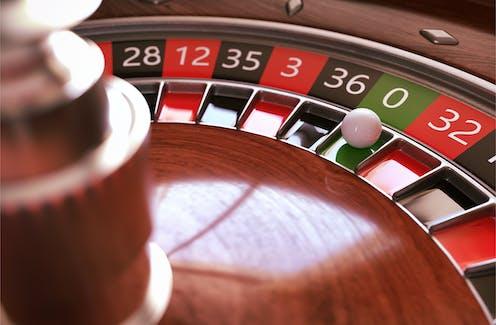 Roulette wheel, ball on zero.