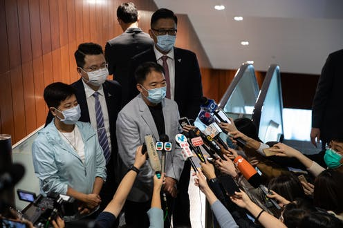 Former pro-democracy lawmakers Helena Wong, (L), Wu Chi-wai, (2L), Andrew Wan, (2R), and Lam Cheuk-ting, (R), speak to reporters.
