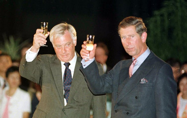 Chris Patten, the last governor of Hong Kong, and Prince Charles drinking a loyal toast in the garden of the British residency before the 1997 handover.
