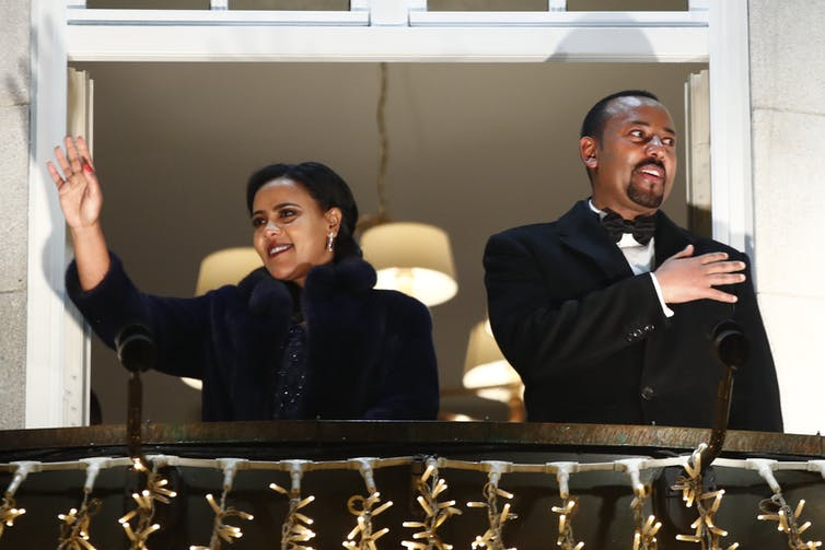 Ethiopian prime minister Abiy Ahmed and his wife Zinash Tayachew wave to photographers in Oslo, Norway, December 2019.