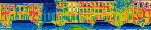 heat radiates from houses on a city block except for one