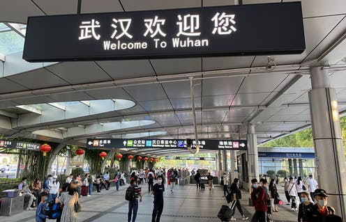 A sign at a train station welcoming people to Wuhan.