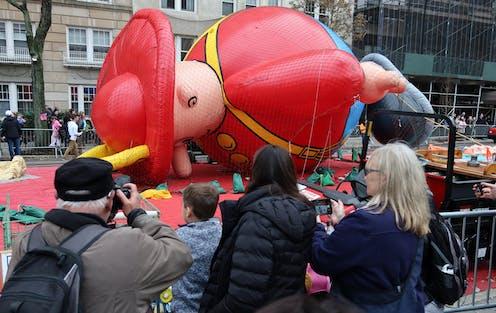 Harold the Fireman balloon lies face down.