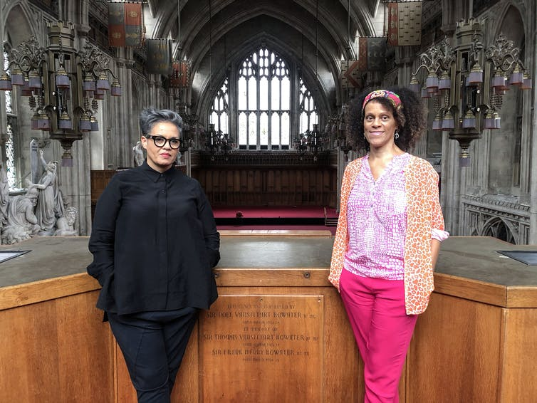 Writers Bernadine Evaristo adn Kit De Waal stand in a church.