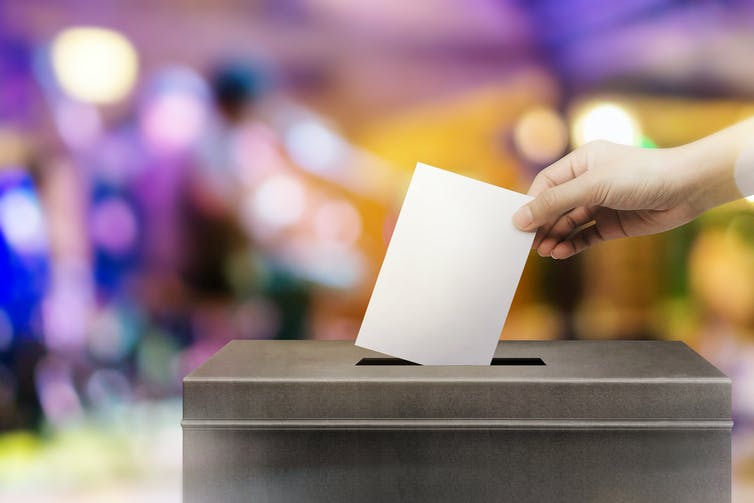Person casting a vote.
