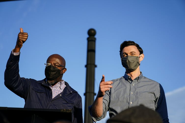 Georgia Democratic Senate candidates Raphael Warnock and Jon Ossoff during a campaign rally