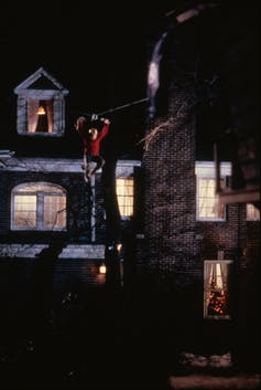 Kevin movies between buildings on a flying fox.