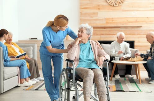 Nurse with residents in an aged care home