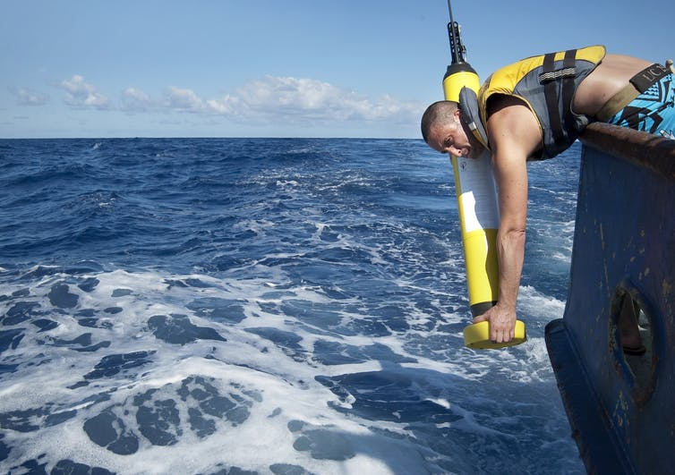 Marine scientist deploying an ocean probe