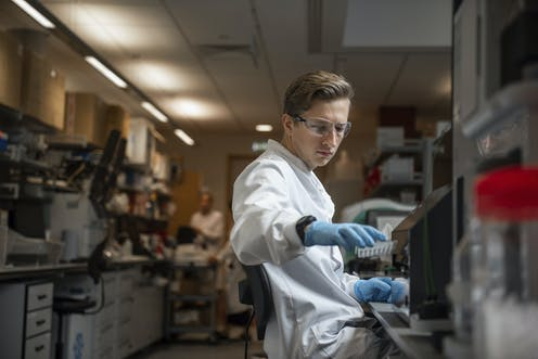 Researcher works on a COVID vaccine
