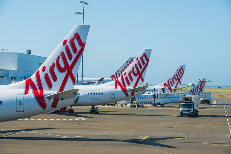 Virgin planes are lined up on the asphalt.