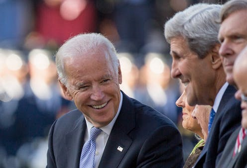 Then-Vice President Joe Biden talks with John Kerry in 2015.