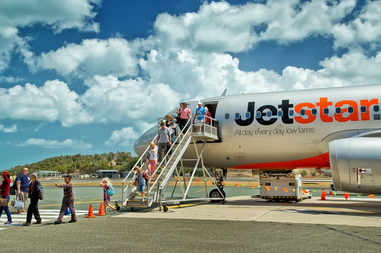 People board the Jetstar flight.