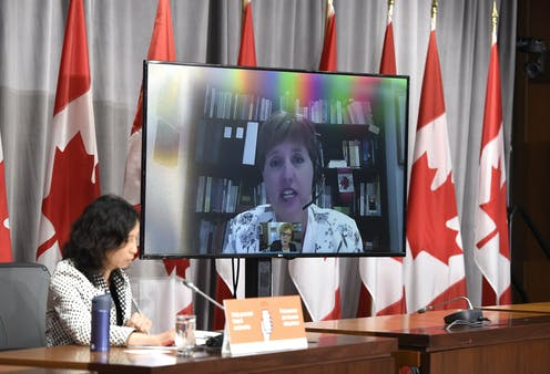 Marie-Claude Bibeau is seen on a videoconference display as Dr. Theresa Tam listens