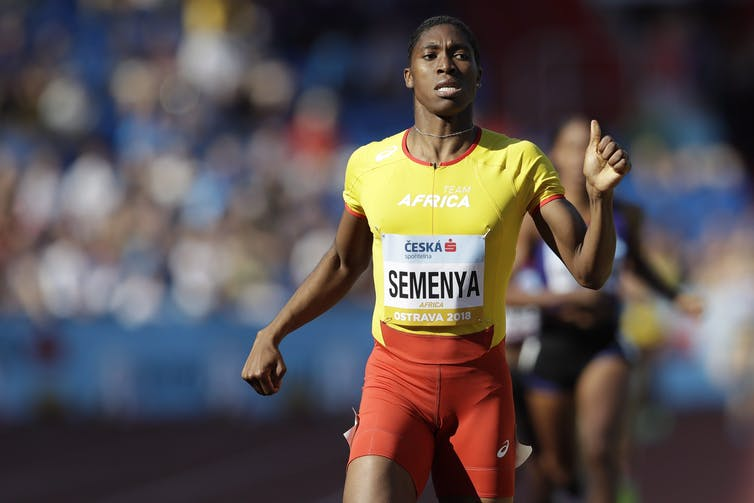 Athlete Caster Semanya crosses the finish line after winning an 800-metre race.