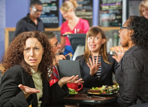 Image of people arguing over lunch.