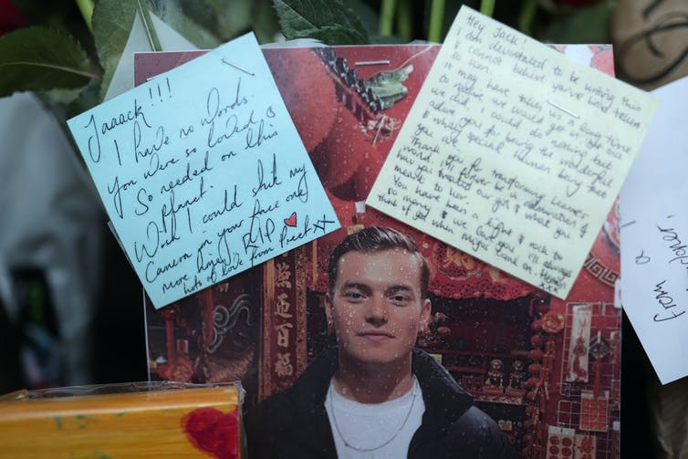 A photo of London Bridge victim Jack Merritt surrounded by letters and flowers.