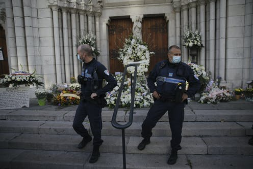 Policemen standing guard in front of a church.