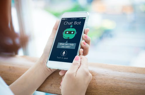Person using chatbot on smartphone.