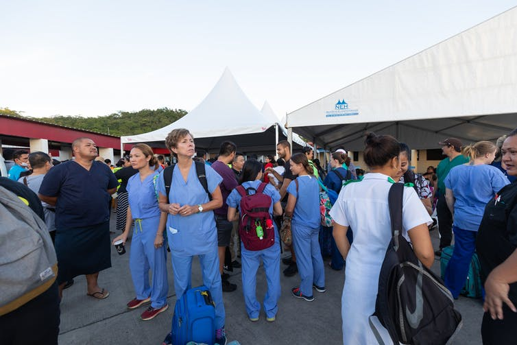 Medical staff in outdoor setting