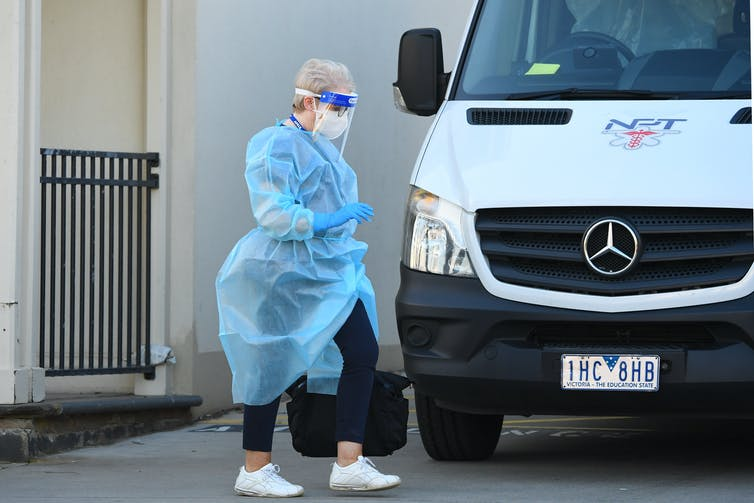 An aged care worker wearing personal protective equipment