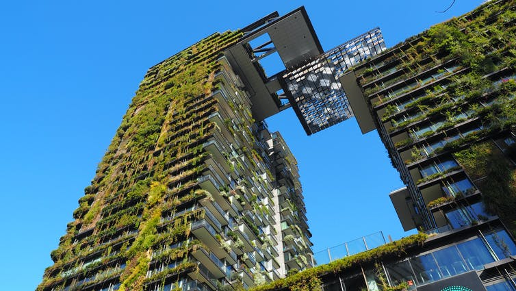 Tall buildings covered in green plants