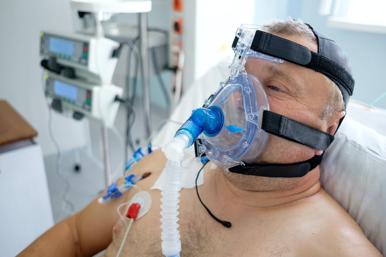 A man wearing a CPAP mask