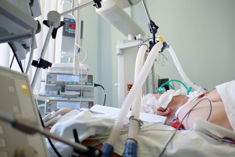An intubated patient receiving invasive respiratory support