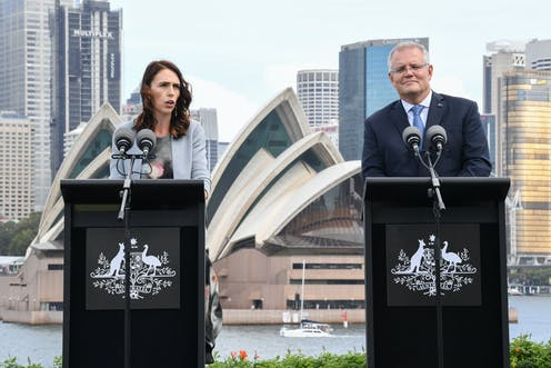 Jacinda Ardern and Scott Morrison with Sydney Opera house in background