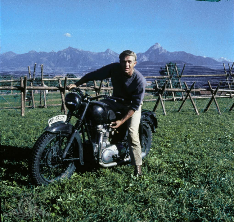 Handsome man on motorcycle from 1960s movies