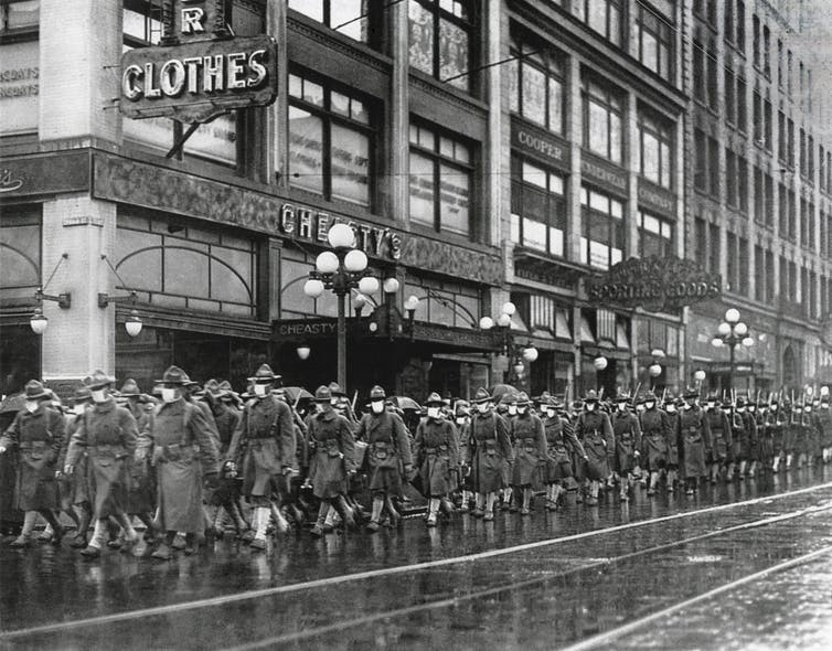 Army workers wearing masks in Seattle, USA, 1918
