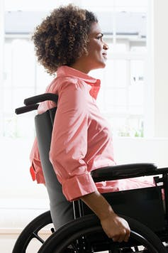 A young black woman using a wheelchair
