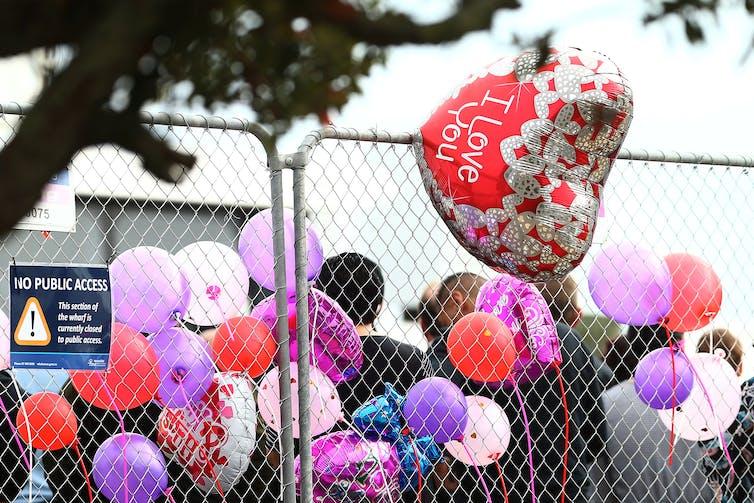 Balloons marking the victims of the Whakaari eruption