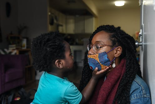 Sevonna Brown of Black Women's Blueprint, a mutual aid group, with her son in New York City. Mutual aid groups have formed in the city to address the economic plight caused by the pandemic.