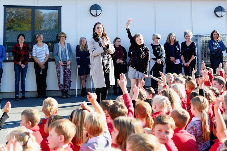 Jacinda Ardern with school children