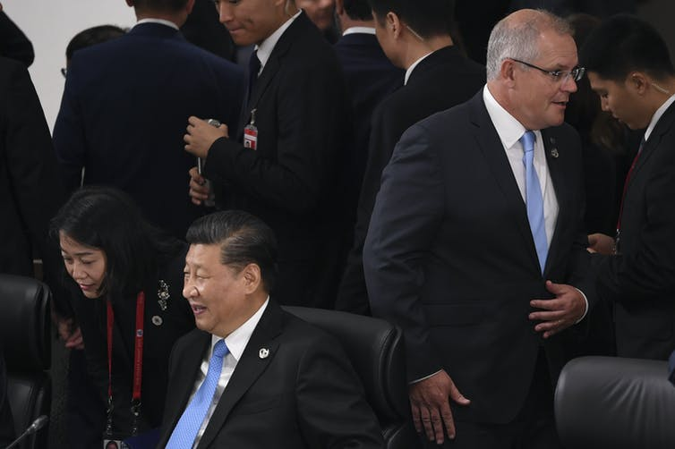 Scott Morrison walks past Xi Jinping at the G20 in June 2019.