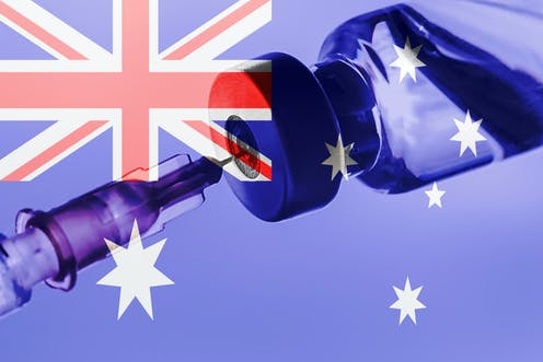 A vaccine vial with an Australian flag in the background.