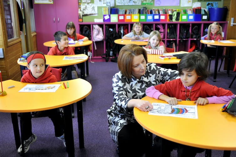 Julia Gillard with a student sitting the NAPLAN test.